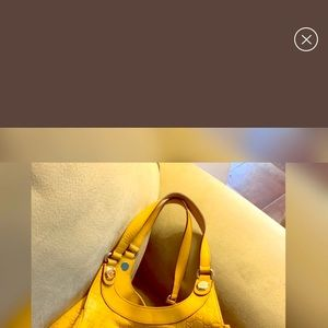 Yellow Gucci bag excellent condition..it's a small